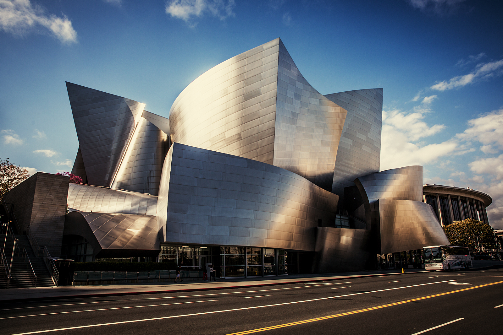 The Walt Disney Concert Hall at 111 South Grand Avenue in Downtown of Los Angeles, California, is the fourth hall of the Los Angeles Music Center and was designed by Frank Gehry. It opened on October 24, 2003. Wikipedia